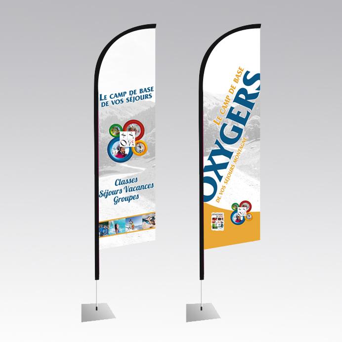 communication visuelle sur PLV drapeaux signalétique pub touristique et tourisme, oxygers location vacances montagne hautes pyrénées